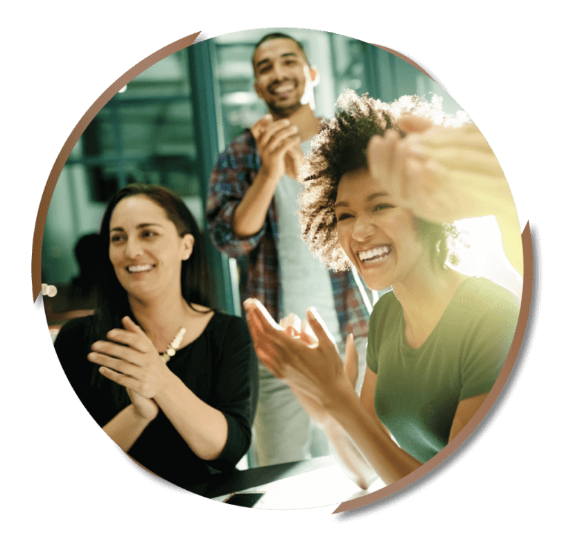 three people clapping and smiling in a coworking space circular image