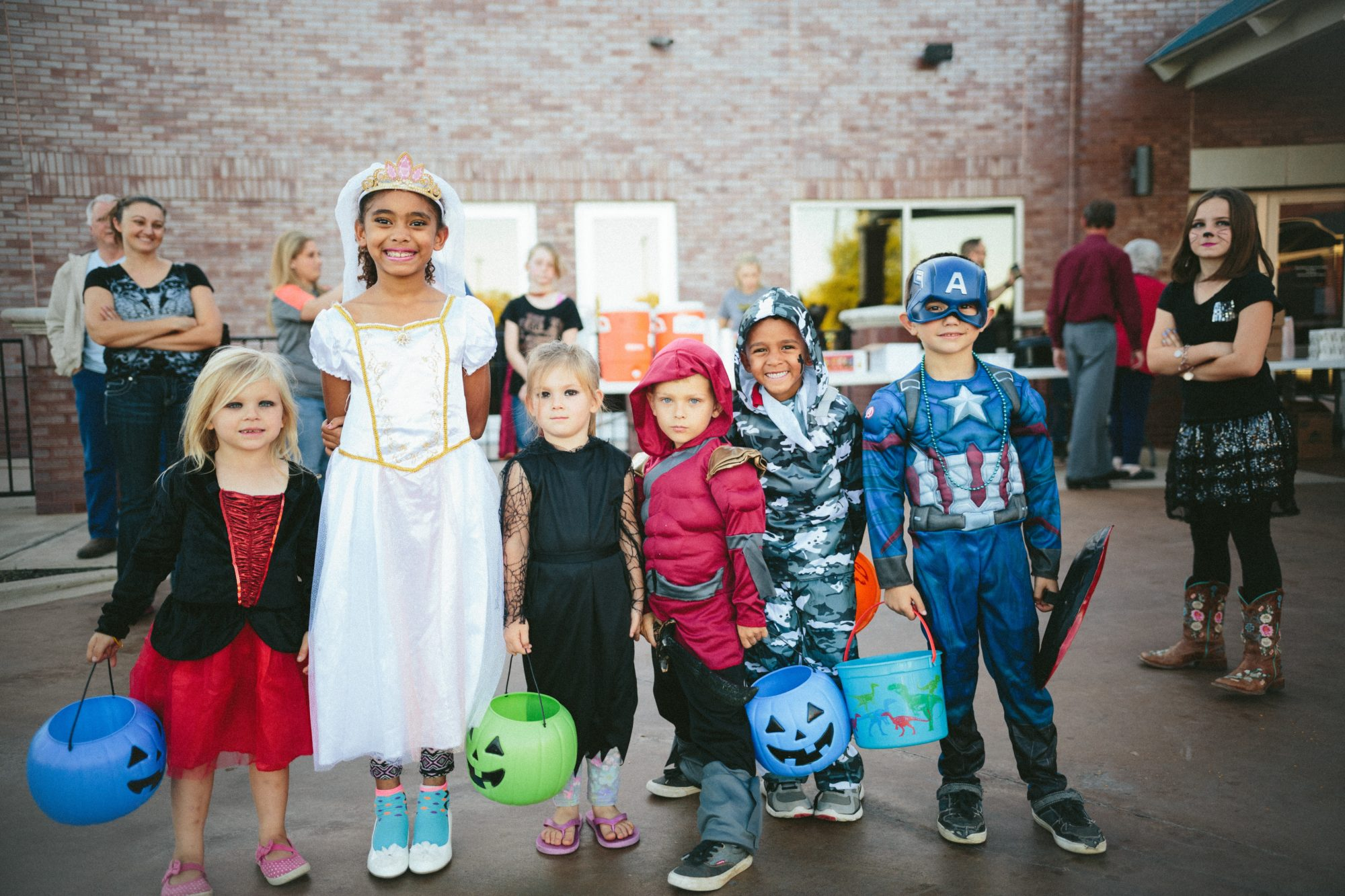 a group of children in Halloween costumes